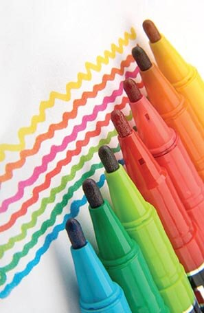 various colored markers making squiggly lines